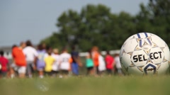 Kids listening with shallow DOF on soccer ball Stock Footage
