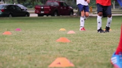 Kids developing footwork during soccer practice training Stock Footage