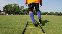 Handheld shot of Soccer Training working on foot work Stock Footage