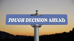 Tough decision ahead road sign with flowing clouds Stock Footage