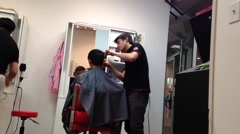 Men having an haircut in a hairdressing salon Stock Footage