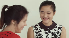Young Asian Women Enjoying Tea and Laughs Together Stock Footage