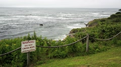 Warning, Do Not Cross Rope, Extreme Danger warning sign overlooking ocean Stock Footage