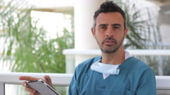 Doctor holding a tablet Stock Footage