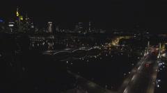 Aerial view Frankfurt am Main night traffic car street bridge river panorama bus Stock Footage