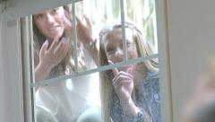 Teen Girls Show Up To Sneak Their Friends Out Of The House, They Try To Be Quiet Stock Footage
