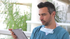 Young male medical nurse with tablet Stock Footage