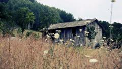 Old wooden shed in the country, establishing panning shoot, vintage Stock Footage