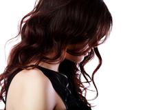 Side portrait of a beautiful woman with curly hair Stock Photos