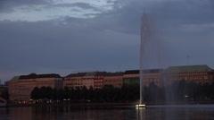 ULTRA HD 4K Alster Lake Artezian well fountain twilight night cityscape Hamburg Stock Footage