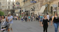 Graben street with old buildings in the old town of Vienna, people walk Stock Footage