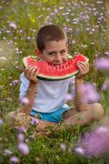 Child eating watermelon Stock Photos