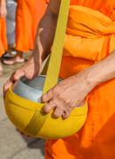 Buddhist monk with alms Stock Photos