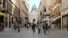 Kohlmarkt street with the Hofburg Palace in the center, people walk Stock Footage