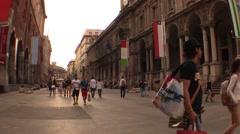 Milan, via dei mercanti, tourists and pedestrians walking Stock Footage