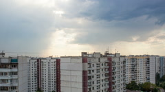 Timelapse of clouds gathering in sky over the city - stock footage