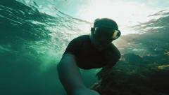 Snorkeling by the coral reef Stock Footage