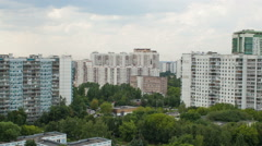 Timelapse of residential area with clouds in the sky above - stock footage