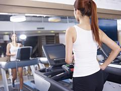 young woman on treadmill - stock photo