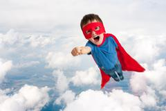 Superhero child boy flying Stock Illustration