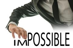 changing word impossible into possible - stock photo