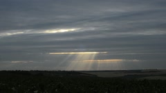 Sunset with sunbeams move on the clouds and its make night, time lapse 1080p - stock footage