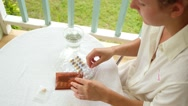 Stock Video Footage of Woman Taking Pills and Tablets.