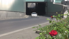 Cars driving in and out of underground traffic tunnel, car motion in big city Stock Footage