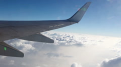 HD - Above the clouds, Wing of airplane flying in the air Stock Footage