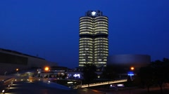 Bmw museum and headquarters in munich at night, bavaria, germany Stock Footage