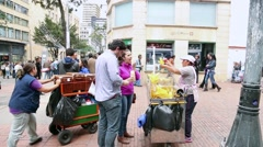 People buy the famous fried banana sweet in Bogota, Colombia. Stock Footage