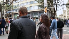People walk through the downtown street in Bogota, Colombia. Stock Footage