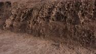 Stock Video Footage of 4K Beautiful Raging Muddy Waterfall Cascades Splashes Close Up