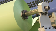 Roll of paper in the machine for printing newspapers Stock Footage