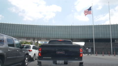 Inside car waiting to cross the US border from Canada Stock Footage