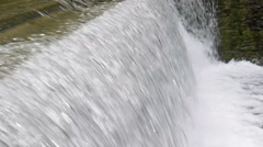 Fast running water at a water gate Stock Footage