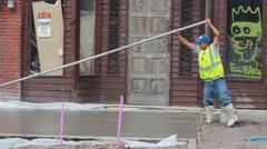 Concrete Worker Pulling a Bullfloat Stock Footage