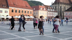 Couples dancing tango, street, flash mob, central square, medieval European town Stock Footage