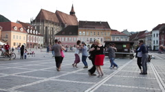 Couples dancing on the street, flash mob, medieval European town Stock Footage