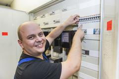 Electrician on cabinet Stock Photos