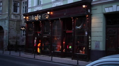 Chick cafe in old European town, exterior, old fashion pub, club,evening traffic Stock Footage