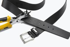 Belt with hole punch Stock Photos