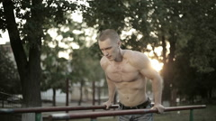Soldier athlete pulls on the bar. Long shot Stock Footage