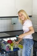 Woman admits a dishwasher - stock photo
