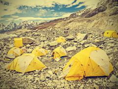 Tents in everest base camp in cloudy day, nepal, vintage retro style. Stock Photos