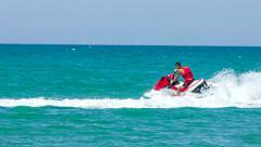 Man extreme rides a jet ski Stock Footage