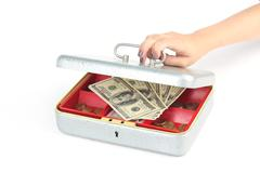 hand closing box with dollars - stock photo
