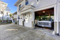 house exterior. view of garage and driveway - stock photo