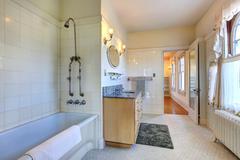 spacious bathroom interior with vanity cabinet - stock photo