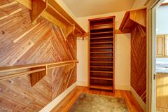 empty closet with wood paneled walls - stock photo